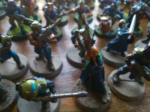 A dastardly psyker and his cultist retinue.