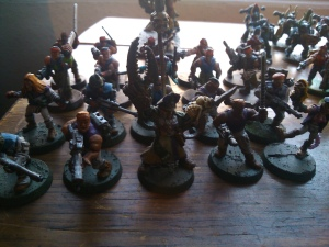 A commissar has turned to chaos.  Oh such heresy!  His quad include an Heroquest elf and a Blood Bowl Chaos Cheerleader!