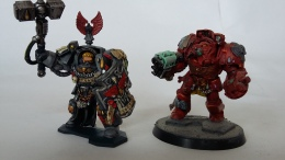 The red chap was my first attempt at painting Blood Angels. It wasn't very successful, so I have rechristened him a Techmarine in Terminator armour.